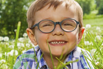 203x136---happy-child-in-a-field