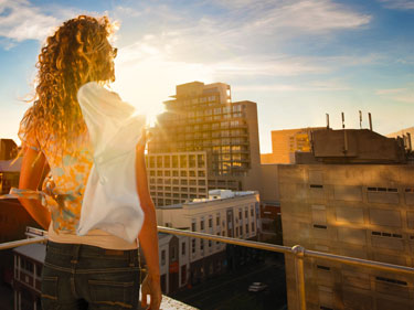 375x281-transitions-girl-on-a-rooftop